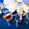 cans and brushes on the blue background